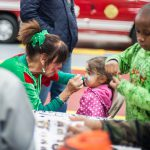 Kids gathered for face painting and ornament decorating at the Radnor Fire House