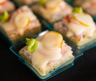 "Mini ""Hot Browns"" on Rye with Smoked Turkey, Avocado, Cherry Tomato, Mornay Sauce"