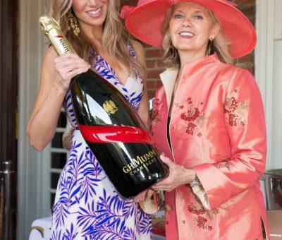 Kristy Sevag, Kathy Bajus and a big bottle of G. H. Mumm Champagne!