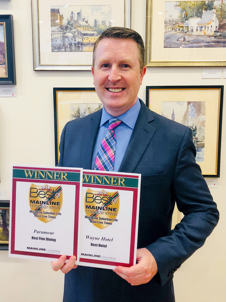 David Brennan, General Manager of the Wayne Hotel, accepts the Main Line Media News Readers' Choice Awards for the Wayne Hotel and Paramour at the reception on Wednesday, June 13, 2018.