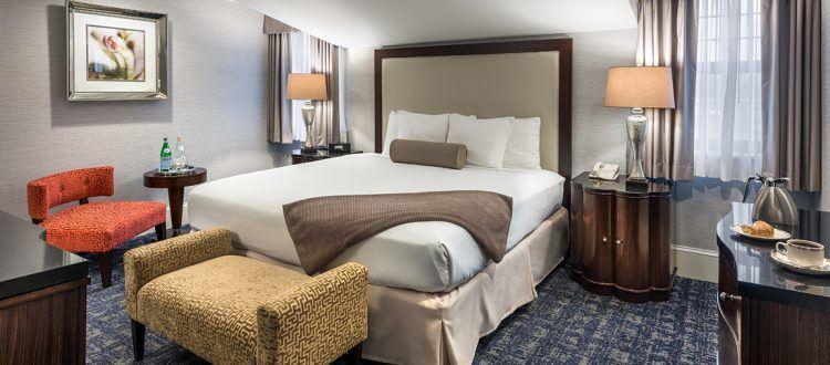 Deluxe Suite Bedroom at the Wayne Hotel